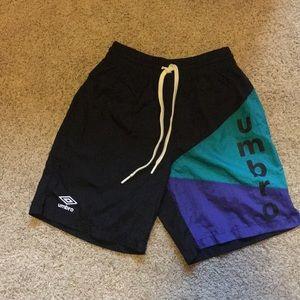 Men's blue, purple, and black Umbro nylon shorts